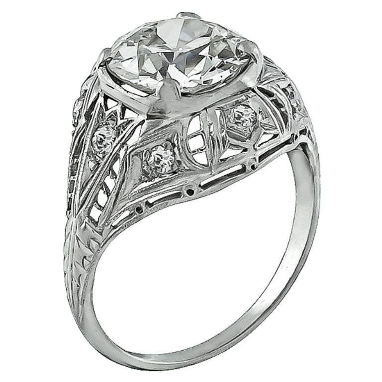 Dating back to the early 20th century, this stunning platinum ring centers an EGL certified old mine brilliant cut diamond that weighs 2.54ct. graded I-J color with SI2 clarity. Accentuating the center stone are dazzling round cut diamond accents.