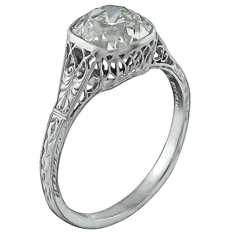 This amazing platinum ring from the Edwardian era, centers a sparkling old mine brilliant cut diamond that weighs 2.09ct. graded J-K color with VS1 clarity. The top of the ring measures 8mm by 11mm and is stamped PLAT. It is currently size 7 1/4,