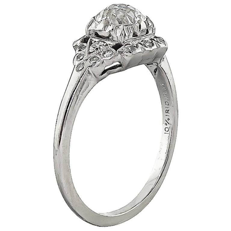 This beautiful platinum engagement ring from the Art Deco era,  is centered with a sparkling GIA certified old European cut diamond that weighs 0.68ct. graded I color  with VS1 clarity. The center diamond is accentuated by round cut diamond accents.