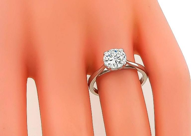 Made of platinum, this ring is set with a sparkling GIA certified round brilliant cut diamond that weighs 1.06ct. graded J color with VVS2 clarity. The ring is currently size 6, and can easily be resized. It is stamped PLAT and weighs 3.8