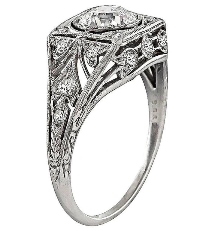 This elegant platinum engagement ring by Black Starr and Frost, is centered with a sparkling GIA certified old mine cut diamond that weighs 0.81ct. graded G color with VVS2 clarity. Accentuating the center stone are high quality round cut diamond