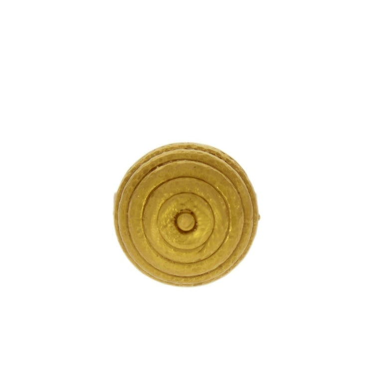 A Classical Greek dome design shield shape top  for a 22kt yellow gold ring made by Ilias Lalaounis circa 1970.  The open cuff shape shank will adjust to most ring sizes. Gold 22K Size: 58 Maker's mark for Ilias Lalaounis.