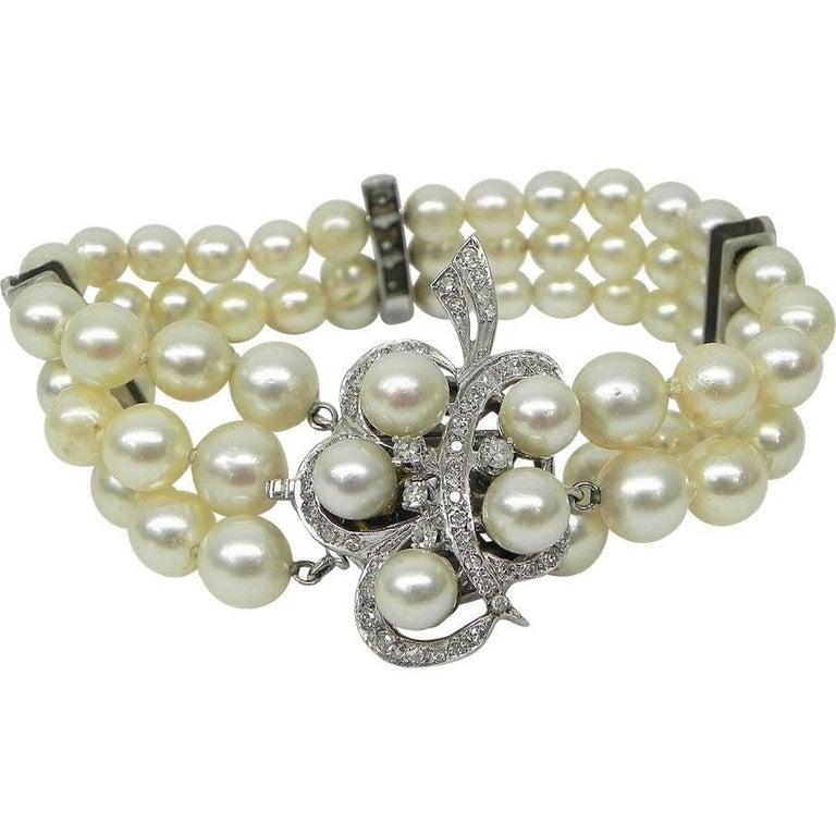 1950s Retro Diamond Clasp Triple Strand Cultured Pearl Bracelet