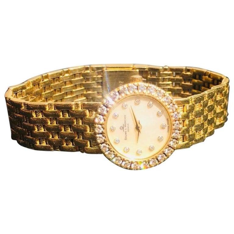 Baume & Mercier Ladies Yellow Gold Diamond Mother-of-Pearl Wristwatch