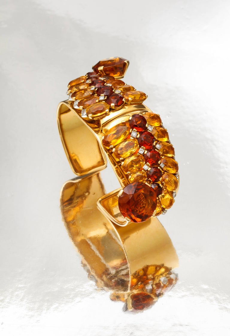 A Very Rare Bracelet by Cartier Paris  Set with multi color fancy cut citrine and diamonds.  Convertible to double clips  Made in France Circa 1940. Which is notable since most Cartier citrine jewelry was made in London workshops.  All three pieces
