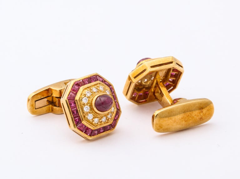 A cuff-links  set adorned by diamonds set in yellow gold with pave diamond and rubies  Made circa 1970