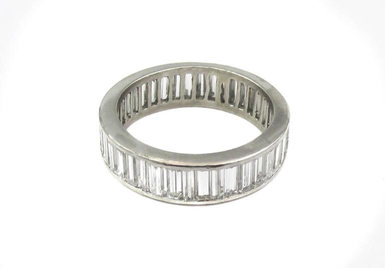 Handcrafted platinum baguette diamond eternity band set with 40 baguette diamonds weighing approximately 4cts. The average color of the diamonds are F and the average clarity VS.  -4 baguette diamonds weighing approx. 4cts total -Average color: