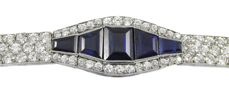 This exceptional Art Deco sapphire and diamond bracelet, which was hand crafted ca. 1925, is set with 218 prefectly matched Old European cut diamonds of the highest color and quality. The total diamond weight is approximately 15cts. Each V-shaped