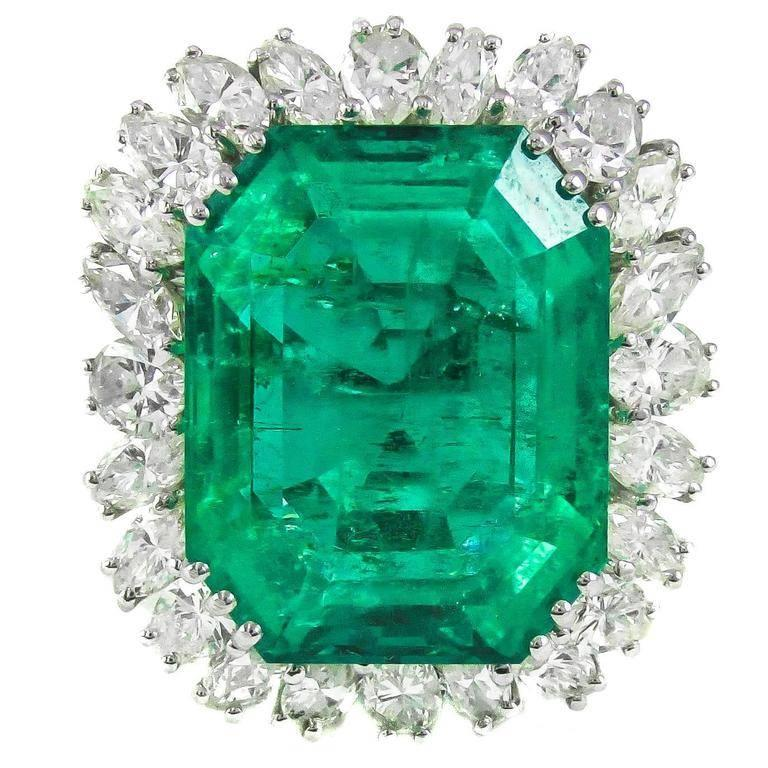 Magnificent Natural Colombian Emerald, weighing approximately 25 carats, set in a custom hand crafted 18 karat white gold mounting. Triple prong set at each corner secure this center gem and it is  surrounded by 25 marquise cut and pear shape