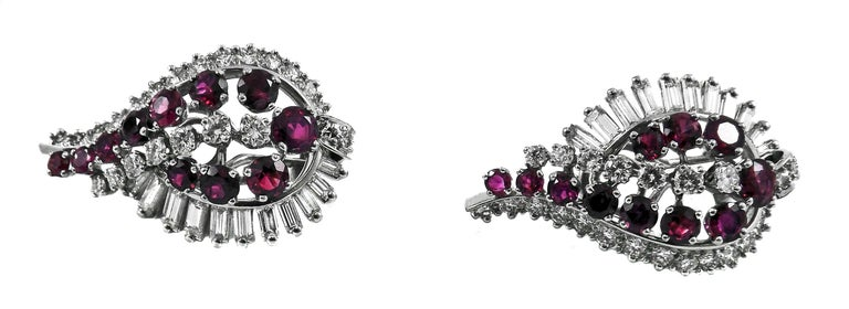 Sexy diamond and Burma ruby ear clips by Gubelin Switzerland, superbly hand crafted out of platinum with 18 karat white gold post and omega clip back. World renowned for its choice of quality gemstones and diamonds, Gubelin has chosen exceptionally
