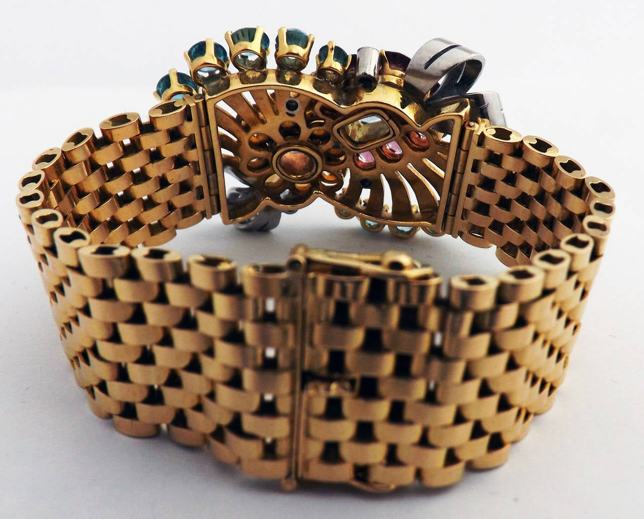 "18 karat pink gold retro gem set bracelet set with 1 pink topaz,1 aquamarine, 7 tourmalines, 8 citrines, and 14 Blue Zircons.  - Length 6.25"" -Width 1.25"" - Stamped 18ct and makers mark - 73.6 gram - 47.3 dwt"