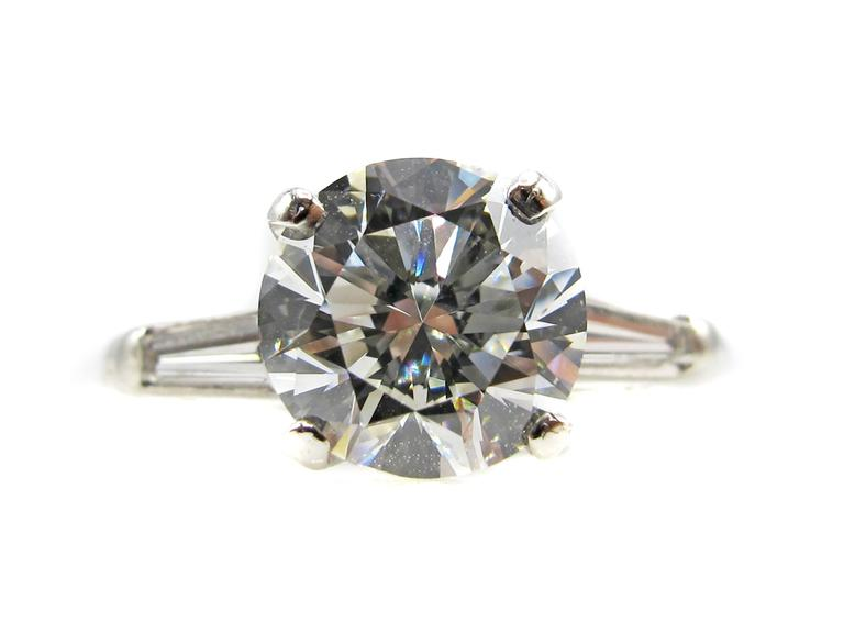 Two-Carat Round Brilliant and Tapered Baguette Diamond Platinum Ring For Sale 1