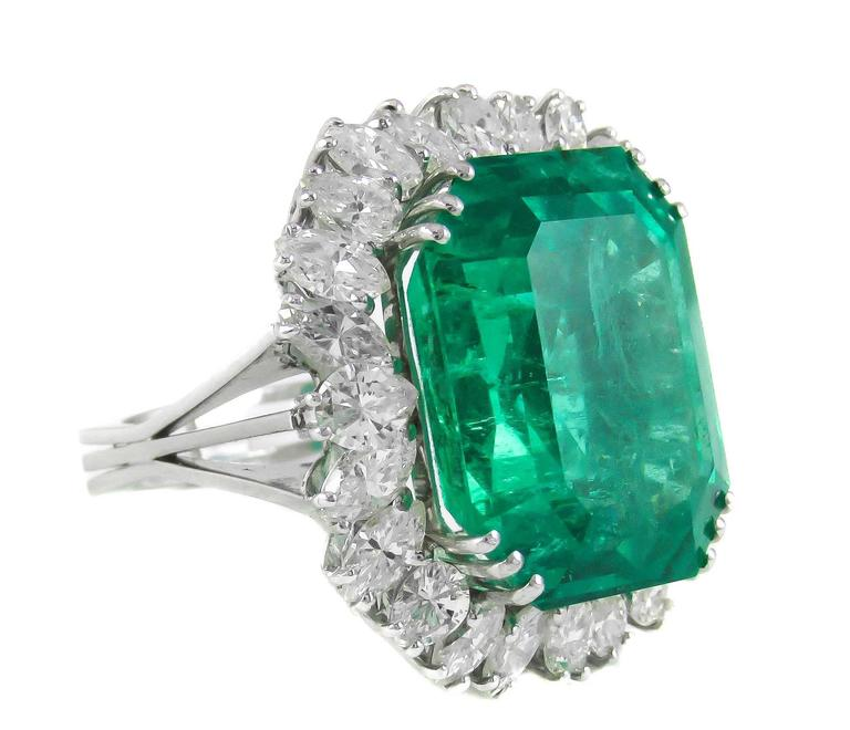 Magnificent Natural Colombian Emerald, weighing approx. 25cts, triple prong set at each corner and surrounded by 25 marquise cut and pear shape white diamonds create a sparkling stage to showcase this outstanding Emerald. 