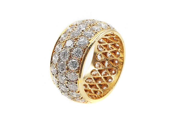 This exceptional hand-crafted eternity band by Van Cleef & Arpels Paris is meticulously set with 66 bright white and sparkly round brilliant cut diamonds. The estimated total diamond weight is approximately 5.6 carats and each of the diamonds has