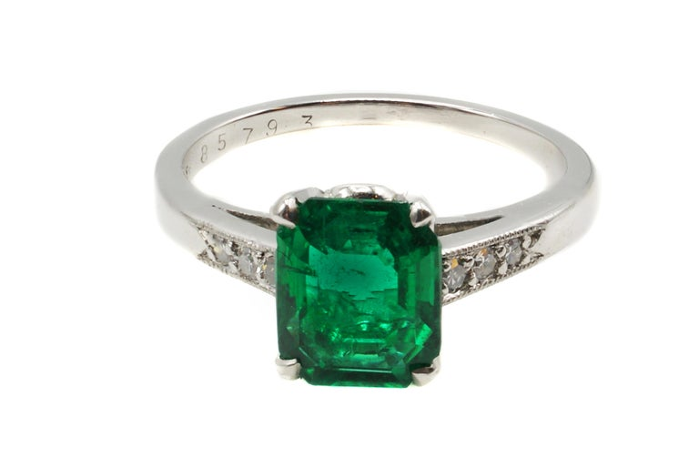 This original Art Deco ring, ca. 1925, by Cartier features a rare no-oil Colombian emerald weighing 1.72 carats. The luscious deep forest green emerald perfectly cut as a rectangular step-cut brings an amazing life to this gem. Accompanied by a