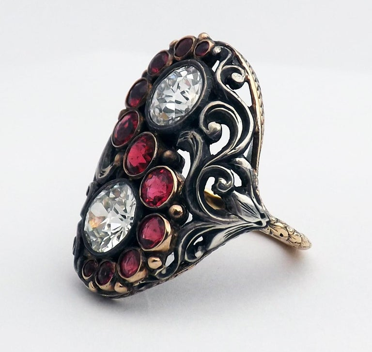 Unusual early Art Deco silver, yellow gold, red spinel and Old European cut diamond ring signed CINI. This extremely well hand crafted ring with its top worked in silver, the lower part of the gallery and shank in gold, was most likely a special