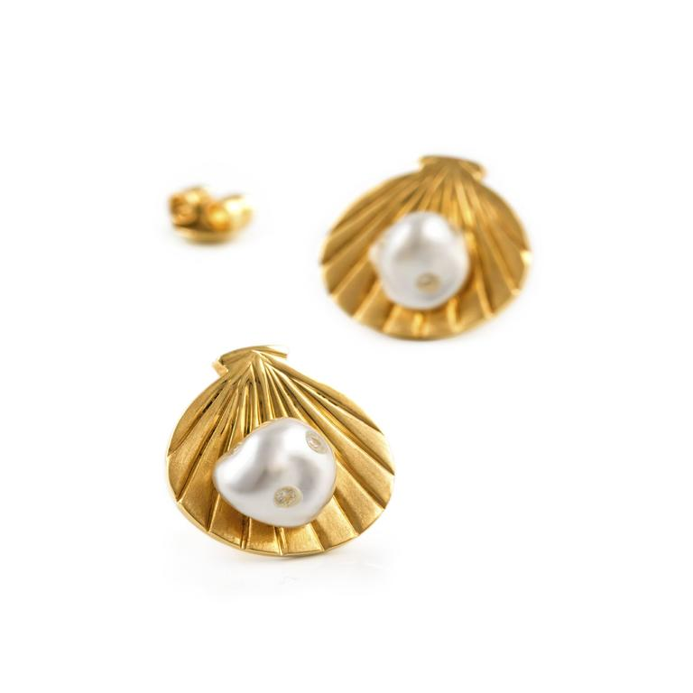 Lust Gold Harvest stud earrings of 18ct yellow gold with soft edged white South Sea keshi pearls of high luster embellished with 0.10 carat brilliant cut white diamonds..  Stunning earrings with a feel of the ocean...   These earrings are designed