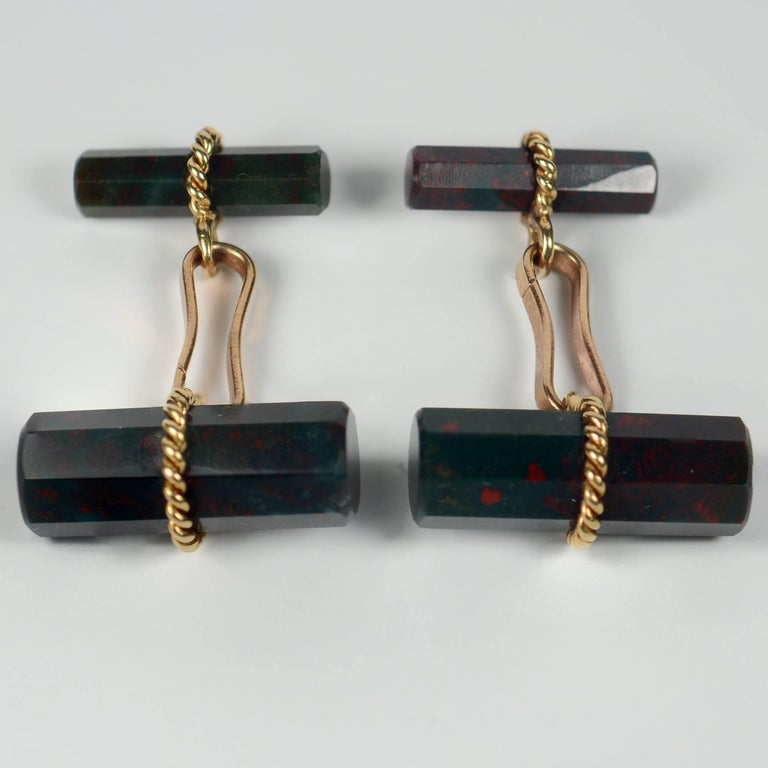 A smart pair of cufflinks by the French house Marchak, set with two octahedral cylinders of bloodstone quartz (a variety of chalcedony agate) with twisted gold wires. The bloodstone shows good coloration of red specks on a dark green ground.  The