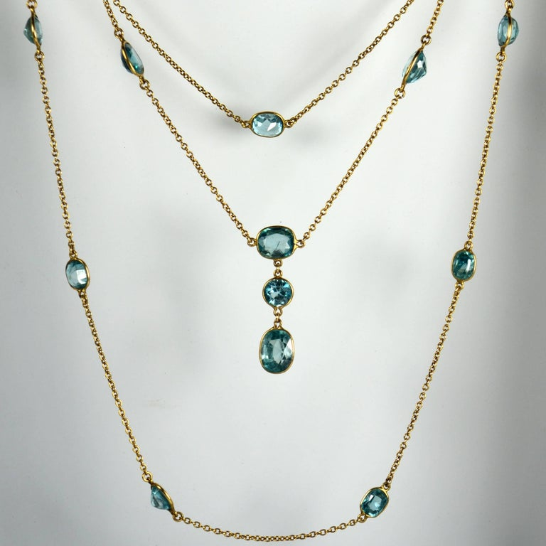 A fabulously long chain necklace in unmarked 14 carat gold set with 23 oval and round-cut blue zircons. The zircons are spectacle-set to the chain and are estimated to weigh approximately 43 carats in total.  This wonderful piece measures 108cm in