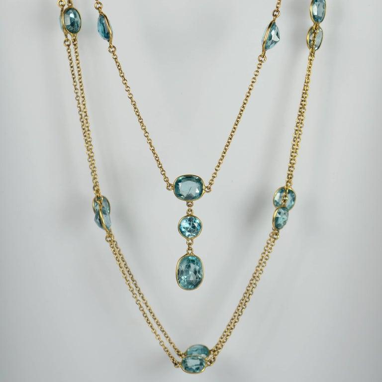 Art Deco Blue Zircon Gold Long Chain Necklace, circa 1920 For Sale