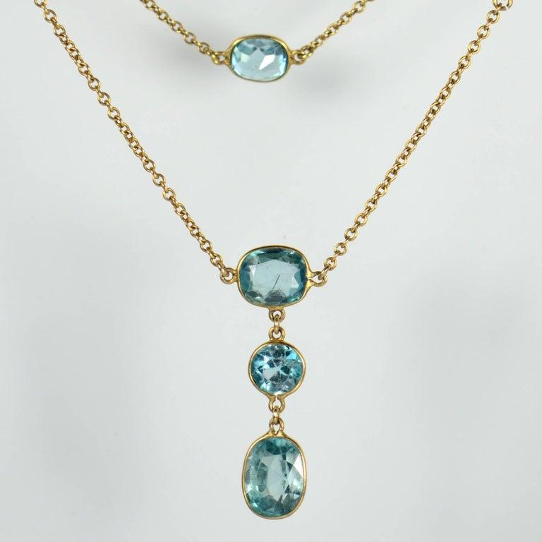 Women's Blue Zircon Gold Long Chain Necklace, circa 1920 For Sale