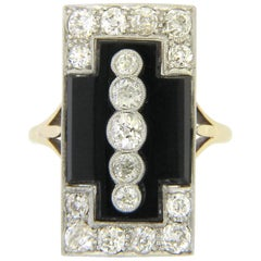 Art Deco Onyx Diamond 1.32 Carat Gatsby Platinum Ring, circa 1920