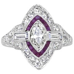 Platinum Art Deco Oval Diamond and French Cut Ruby Engagement Ring