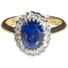Sapphire Diamond Oval Cluster Engagement Ring