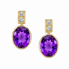 Bezel Set Amethyst and Diamond 18 Karat Yellow Gold Post Earrings
