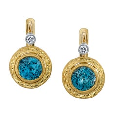 2.56 Carat Blue Zircon with 0.08 Carat Diamonds 18 Karat Yellow Gold Earrings