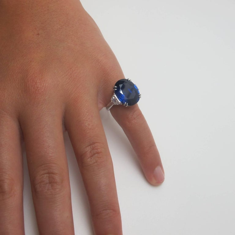 Oval Cut GIA Certified 12.23 Carat Unheated Blue Sapphire and Diamond Platinum Ring For Sale
