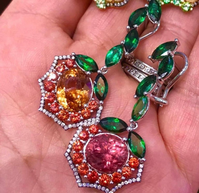 18 K White gold earrings have very rare in color and size: Malaya Garnets, from Tanzania, Pink and Peach oval  gems are perfectly match by cut and size, and two colors do compliment each other, they sparkle like only Garnets can. Accented with