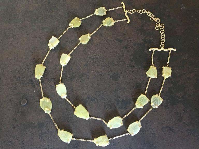Necklace double string with carved leafs in opal very special color, refine carved decoration in gold reproducing leaf and tree branch, the length is adjustable. All Giulia Colussi jewelry is new and has never been previously owned or worn. Each