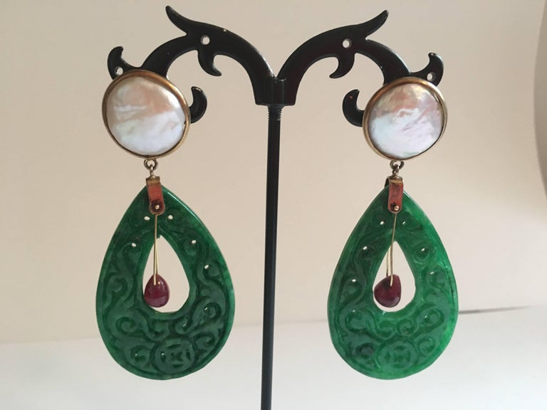 Earring with spinach jade carved drops, Tremblant ruby drop, white made pearls gold gr.12,50 total length 7cm weight 12,80 each. All Giulia Colussi jewelry is new and has never been previously owned or worn. Each item will arrive at your door