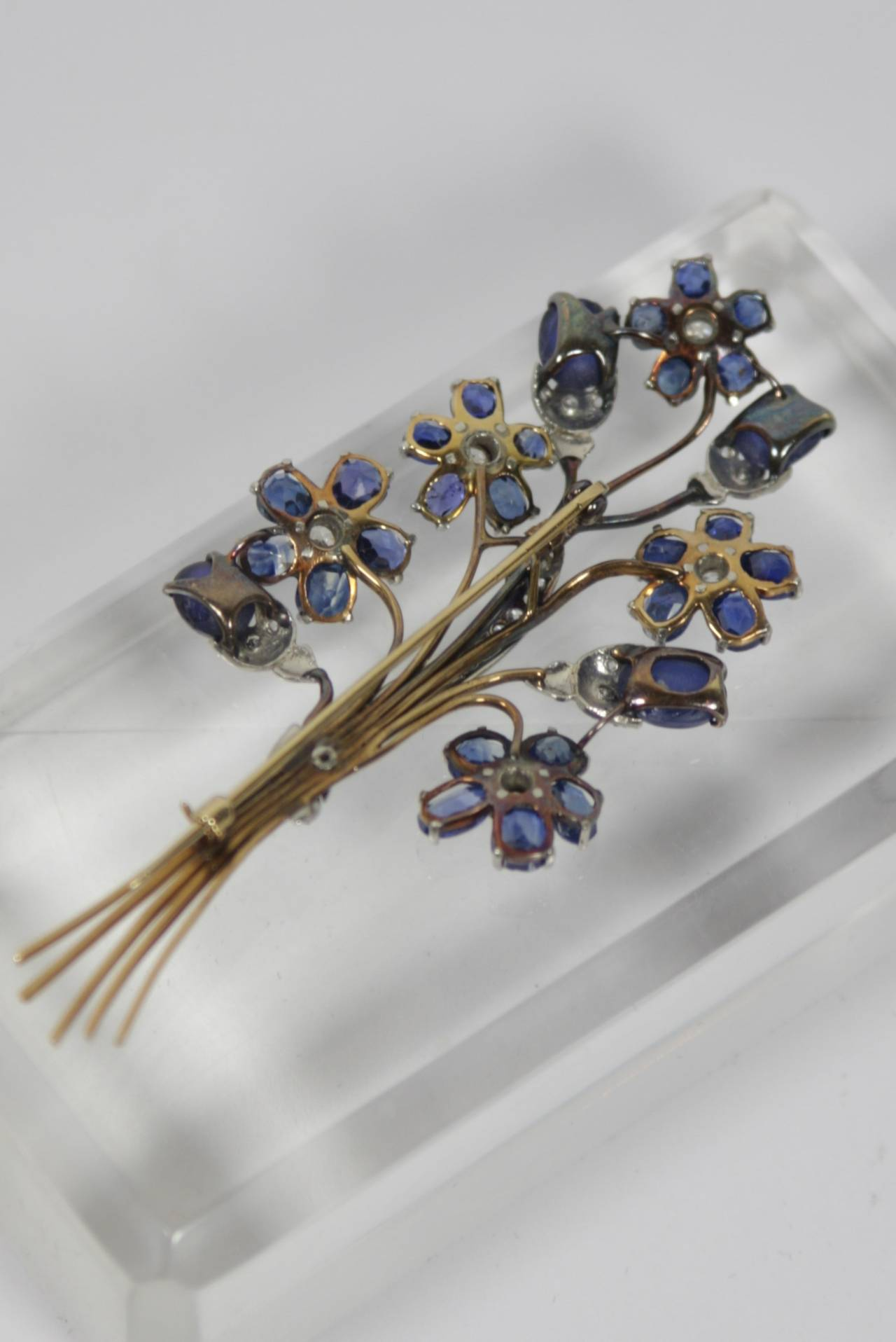 1940s Sapphire Diamond Gold Platinum Floral Brooch In Excellent Condition For Sale In Los Angeles, CA