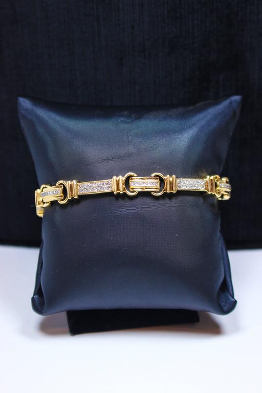 This bracelet is composed of 14kt white and yellow gold with square cut diamonds. Unisex featuring a clasp closure. Specs below. In excellent condition.  Please feel free to ask any questions you may have, we are happy to assist.   Specs: 14 KT
