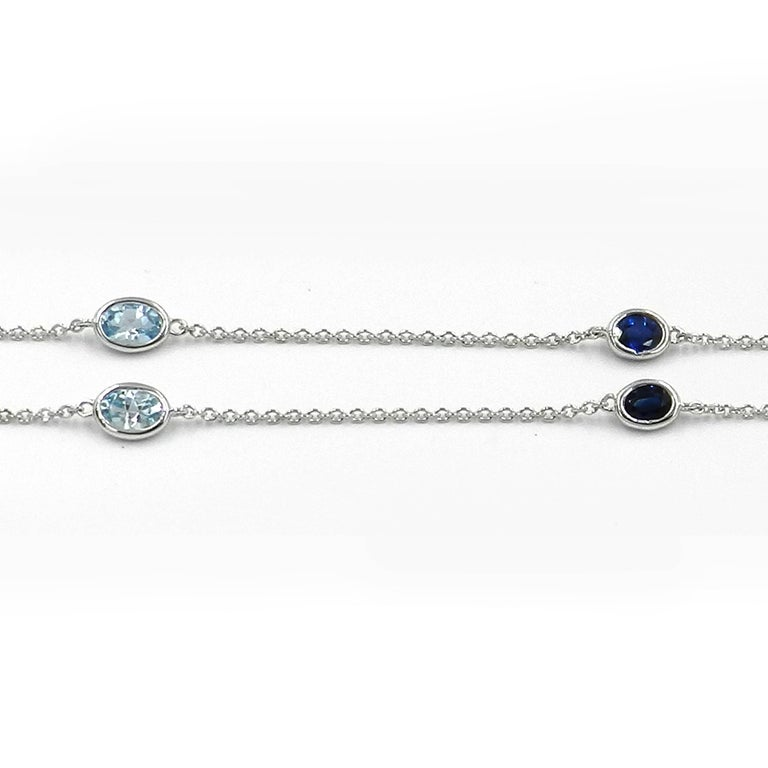 Modern 18 Karat White Gold Garavelli Chain with Blue Topaz and Blue Sapphires For Sale