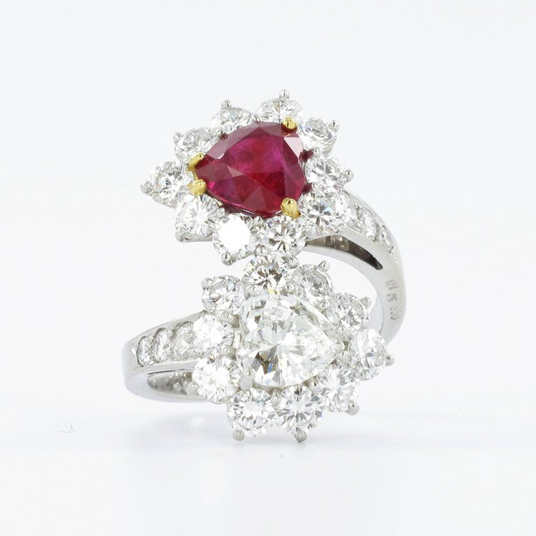 Crafted in platinum 950 this stunning ring features a Gübelin certified untreated heart shape ruby from Burma of approximately 1.75 carats and a heart shape diamond of approximately 0.90 carats with H colour and si1 clarity. Surrounded by 26