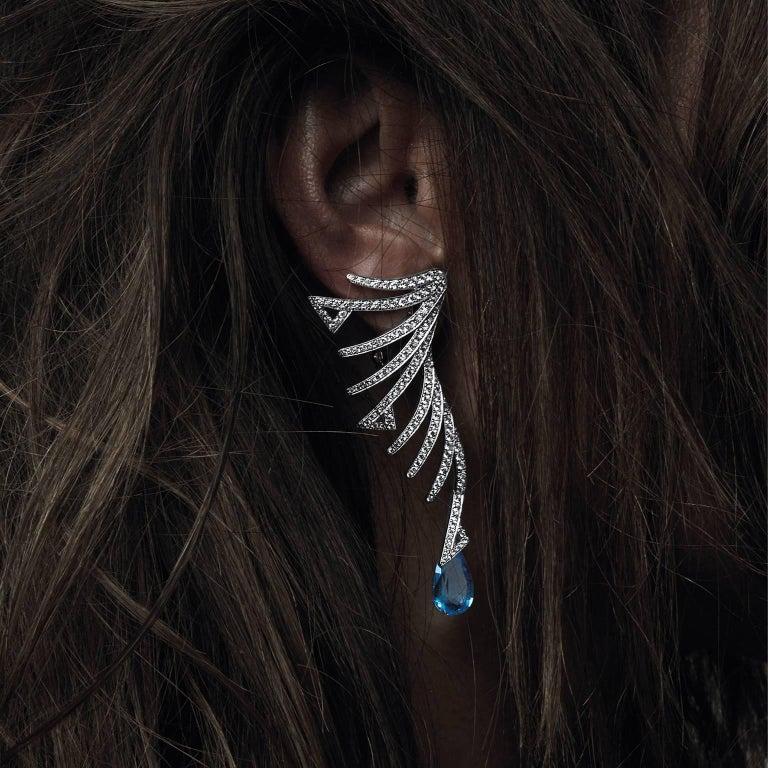 18K white gold AKILLIS Cruella earrings set with Tanzanite and white diamonds.                                                                                                                                   Tanzanite (cts): 10,3  Diamonds (cts):