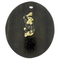 18 Karat Gold and Ebony Pendent with a Fire Enamelled Monkey