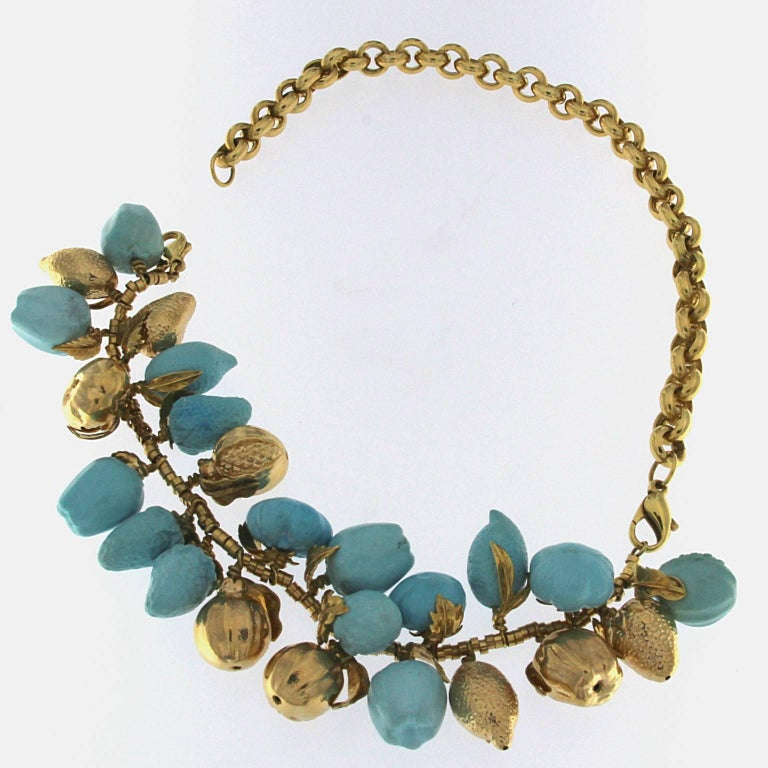 Turquoise and 18kt yellow gold fruit necklace The front part can be worn as a bracelet taking out the back since it has 2 clasps.  Total weight of 18 kt gold: gr 59.60 Total weight of red coral: gr 36,10 Stamp: 10 MI, 750, ITALY