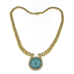 Lion Turquoise Central and Diamonds  in a 18 Karat Gold Necklace and Earrings