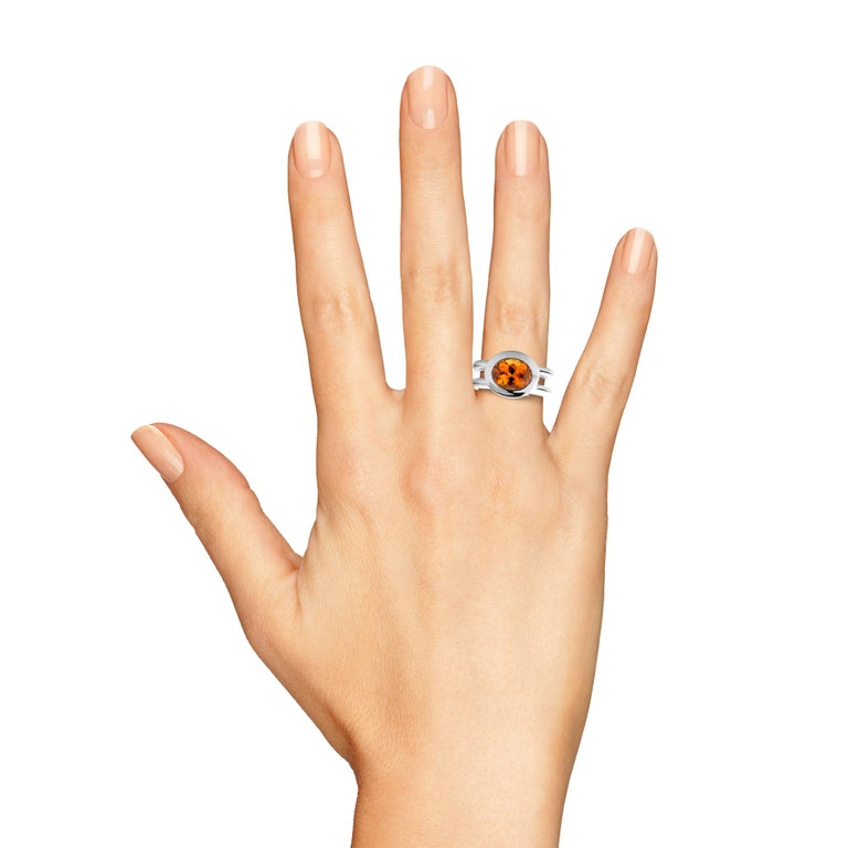 Unique object from Jochen Leën.  Mandarin Garnet 4,25 carat measuring 10 x 8 mm ( perfect Calibrated cut ) Diamonds 4 x 0,05 ct total weight 0,20 carat.