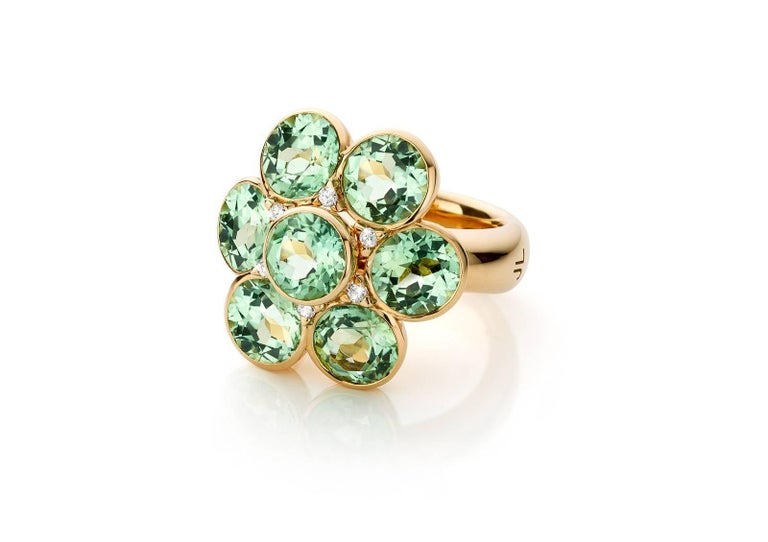 7 vivid green tourmalines set in rose gold and detailed with 6 diamonds.   This rose gold ring holds 7 round tourmalines, each one measures 7,5 mm and 6 diamonds measuring 1,8 - 1,9 mm.  Diamonds : 0,140 Top Wesselton - VS Tourmalines : top quality