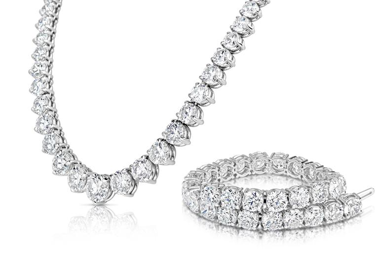 Platinum Riviera Necklace 50.18 Cts. T/W Stones: Round Diamonds Center stone: 3.50 Cts 4 stones: 2.00 Cts. 2 stones: 1.70 Cts. 2 stones: 1.50 Cts. 2 stones: 1.20 Cts. 4 stones: 1.00 Cts. 2 stones: 0.90 Cts. 8 stones: 0.75 Cts. 14 stones: 0.50 Cts. 6