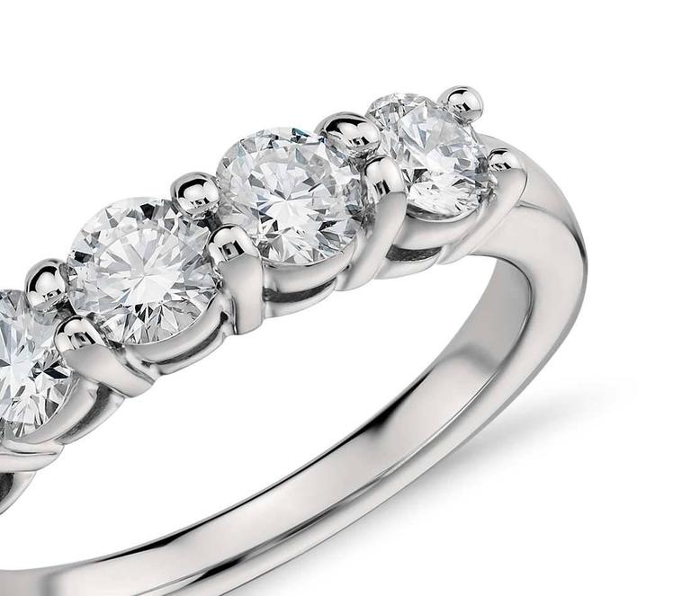 Five sparkling diamonds accentuate this Platinum ring. The diamonds are secured by a common prong with a total weight of 1.63 cts. total.  Special orders are available for this style. F/G SI1/SI2 MetalPlatinum