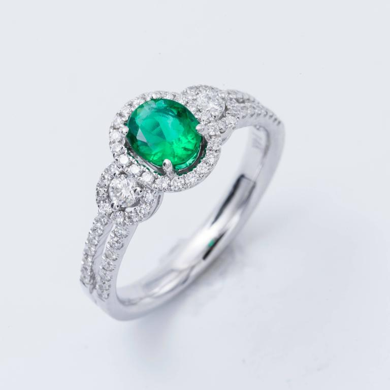 Style: 14k White Oval Shape Zambia Emerald  Diamond Halo Engagement Ring Material: 14k White Gold Gemstone Details: 1 Oval  Shape Emerald approximately 0.50 ct. 6x5mm Diamond Details: Approximately 0.43 ctw of diamonds. Diamonds are G/H in color and