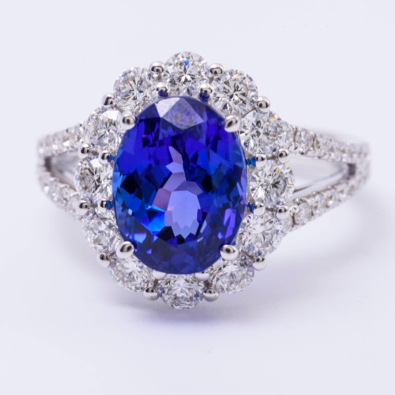 Contemporary Oval Tanzanite and Diamonds Halo Cocktail Engagement Ring 4.85 Carat For Sale