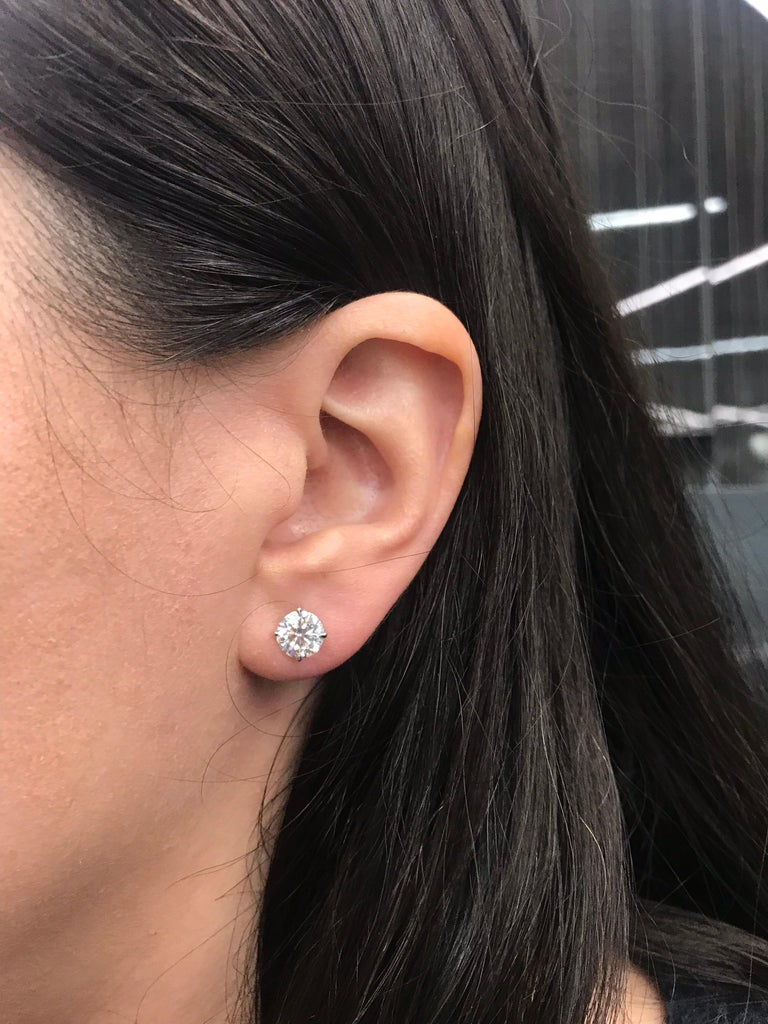GIA Certified diamond stud earrings weighing 2.62 carats in a four prong 18k white gold champagne setting.  Color: H Clarity: I1