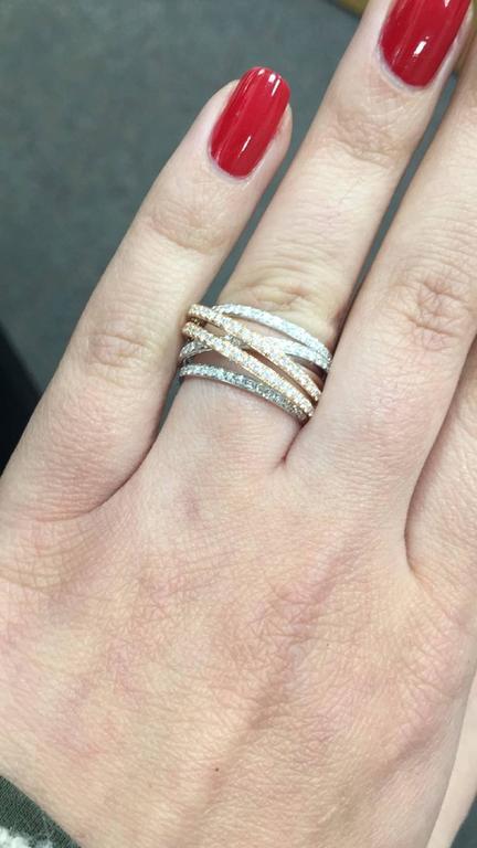 Metal: 18K White/Rose Gold Stone Type: Round Diamonds Diamond Count: 112 Diamond Weight: 1.07 Cts. Diamond Color: G+ Diamond Clarity: SI1+ 3/8